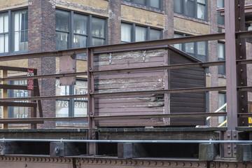 Wooden box sitting on elevated platform