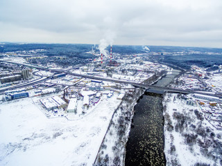 Vilnius, Lithuania: aerial top view of Neris river and Lazdynai Bridge in beautiful colors of winter