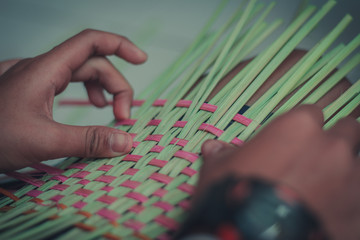 Closeup to hand of Thai students grade 4 in primary school are weaving pattern thai.