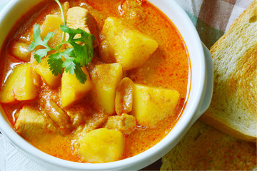 Chicken Mussaman Curry  (Thai  food menu) with toast .
