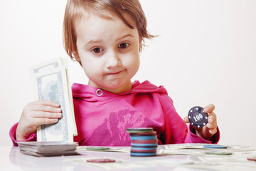 The concept of card games. Set to play poker with dollars and chips. Little child girl gambler playing  Poker Games.