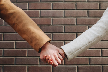 Friendship help trust connection unity concept. Bff holding hands