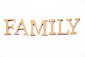 Wood alphabet in family word on white background