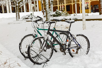Bicycles  are covered in of snow