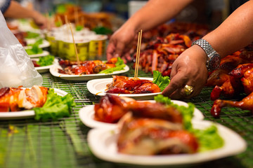 Vendor Serving Meat In Plates At Thai Street Food
