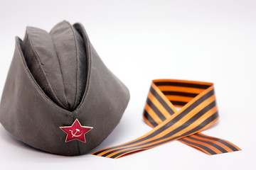 Military cap with Communist decoration, the Red star with hammer and sickle.St.