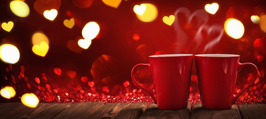 Two Red Cups of Coffee with Hearts