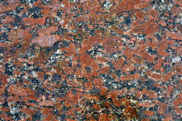close up of a polished red marbled granite texture