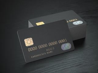 Stack of black blank credit cards mockup on black wood table background,