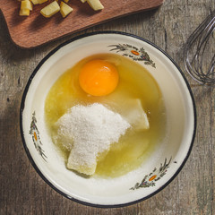 Preparation of raw sweet dough - egg, flour, sugar, vanilla mix in a bowl with a whisk