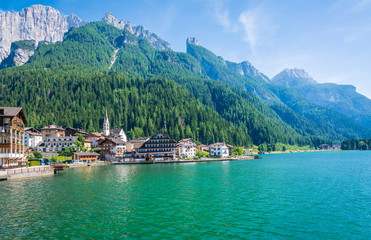 Alleghe, Belluno,italy: a charming mountain village located in a unique natural setting overlooking its fascinating lake , in the geographic heart of the Dolomites UNESCO World Natural Heritage