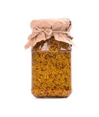 Grain mustard sauce isolated on white background. Mustard beans in a jar isolated on white background. Closeup