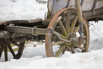 Cicmany, Slovakia. The old cart covered with snow in winter. The village Cicmany with the painted wooden houses is on the list of UNESCO