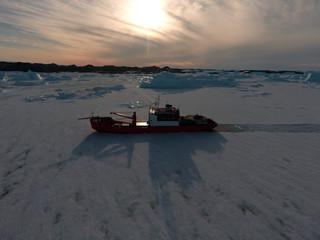 Progress station, Antarctica  January 20, 2016: Cargo ship arrives in port for unloading on an ice floe. Antarctic.