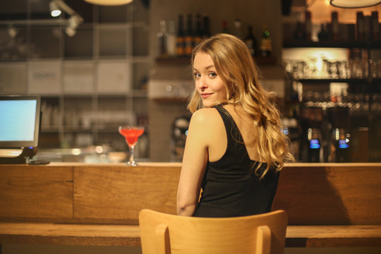 Charming woman sitting at the counter