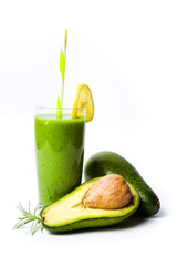 Avocado smoothie in a glass isolated