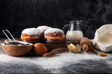 german donuts or berliner with ingredient on grey background