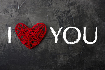 The inscription I love you against a dark background. Valentine's day or wedding. View from above