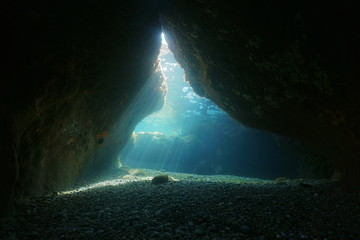 Exit of a cave underwater with natural sunbeams, Mediterranean sea, Pyrenees Orientales, Roussillon, France Wall mural