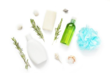 Flat lay natural organic bath products/ Shampoo bottle, soap bar, essential oil, rosemary herbs and blue bath sponge