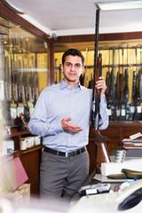 Salesman showing rifle