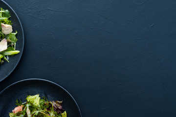 salad plate on blue background. Vegetarian food. Wholesome organic nutrition