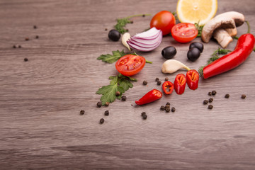Healthy food background / studio photo of different fruits and vegetables on wooden table. Copy space. High resolution product