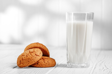 Milk in a glass and oatmeal cookies. The concept is healthy food, breakfast, vegetarianism.