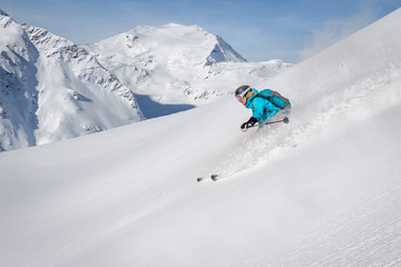 Female freeride skier in the mountains off-piste