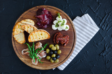 Photo sur Aluminium Entree Assortment of spanish tapas or italian antipasti
