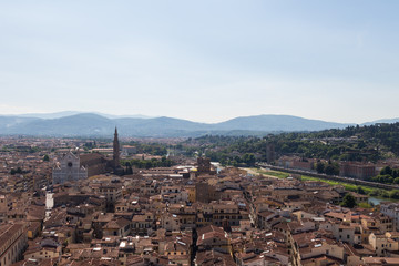 Florentine cityscape with red roofs in a sunny day, Tuscany, Italy.