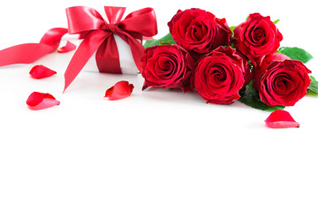 Bouquet of red roses and gift box isolated on white