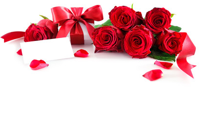 Bouquet of red roses and gift box with empty tag