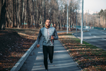 Male runner in sportswear on training outdoor