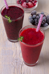 Berry smoothie, garnished with thyme