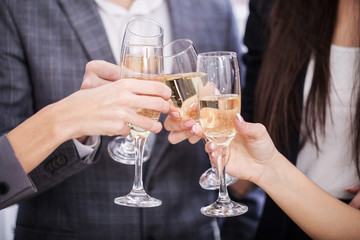 Close up of business team toasting with Champagne