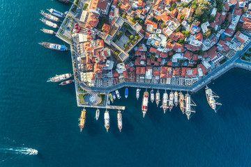 Spoed Fotobehang Luchtfoto Aerial view of boats, yahts, floating ship and beautiful architecture at sunset in Marmaris, Turkey. Landscape with boats in marina bay, sea, buildings in city. Top view of harbor with sailboat.
