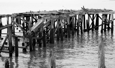 Dilapidated boat dock falling apart on the water