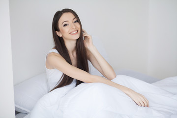 Young woman sleeping on the white bed-clothes in bed at home. Relax night morning rest concept.