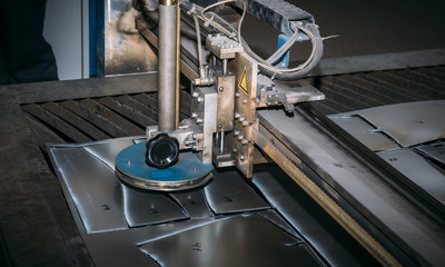 CNC laser plasma cutter. Metalworking technology at factory