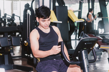 Fitness man execute exercise with exercise-machine at the gym