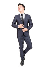 Businessman in black suit standing isolated on white background
