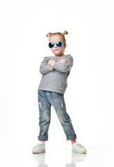 Young girl kid standing in blue aviator sunglasses happy thinking with arms crossed