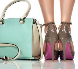 Closeup perfect female legs wearing high heels shoes and woman bag