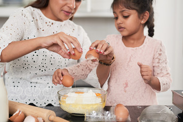 Little Girl Cooking with Mom