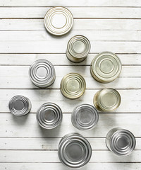 Tin cans with food.