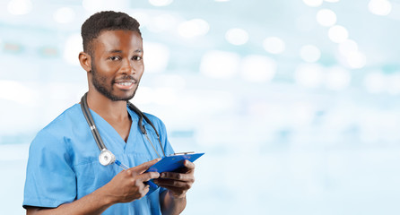 African american doctor with a stethoscope standing against blurred background