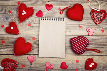 Open blank notebook  with Valentine hearts on old wooden background. Copy space. Valentines day background.