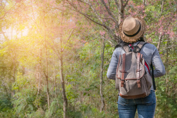 asian girl backpacker on the hill
