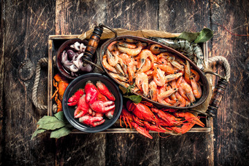 Different seafood in bowls.
